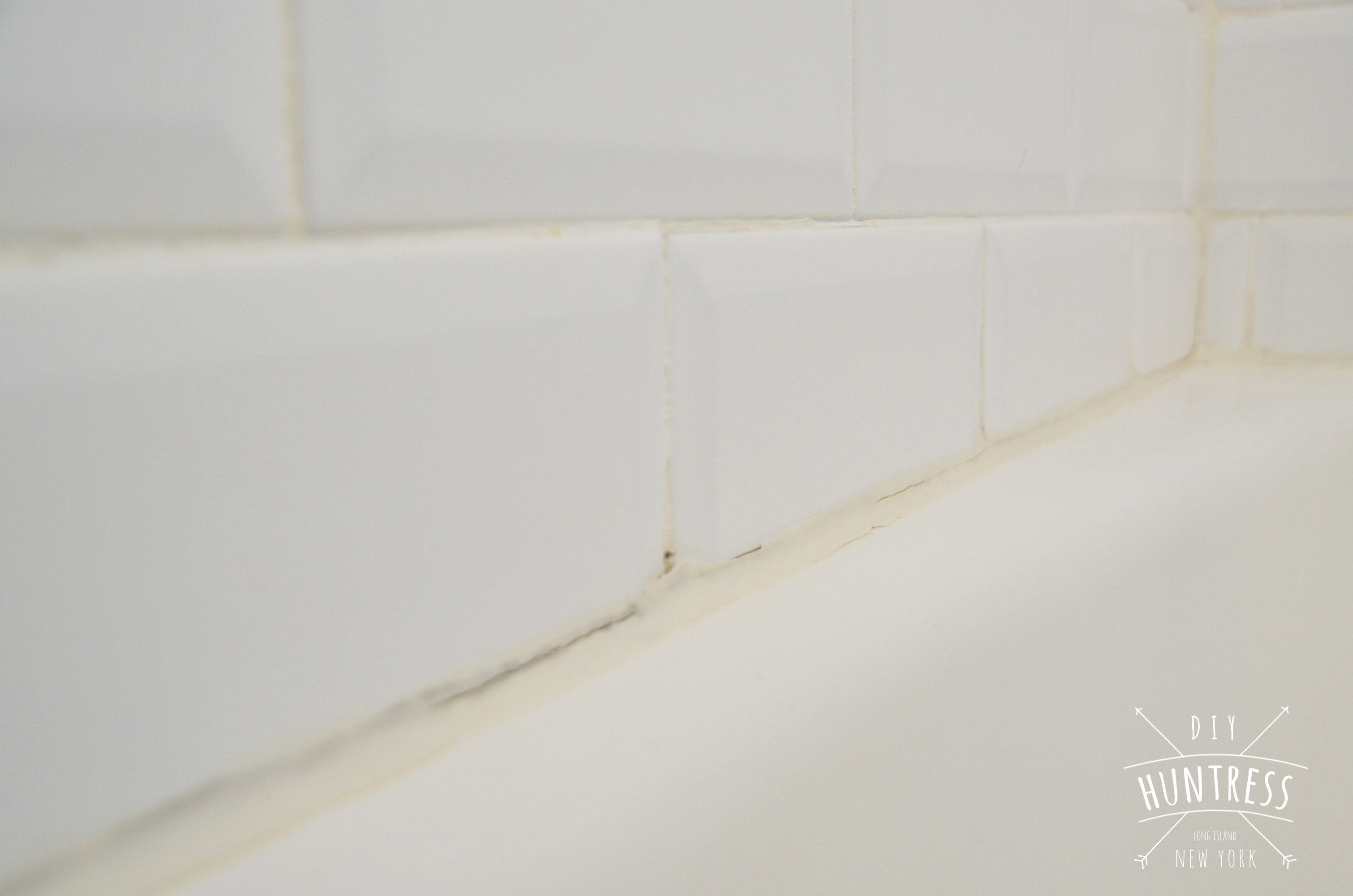 How To Re-Caulk Your Bathtub (The Right Way) - DIY Huntress