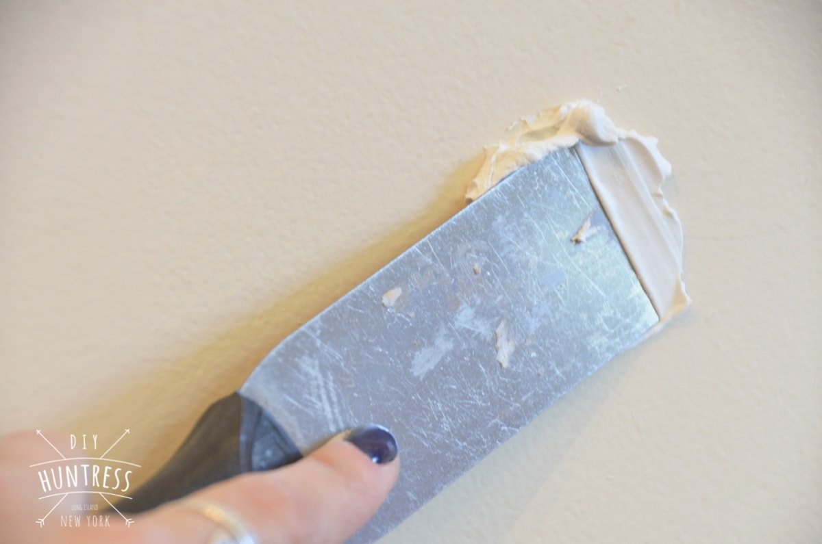 how to fix holes in wall