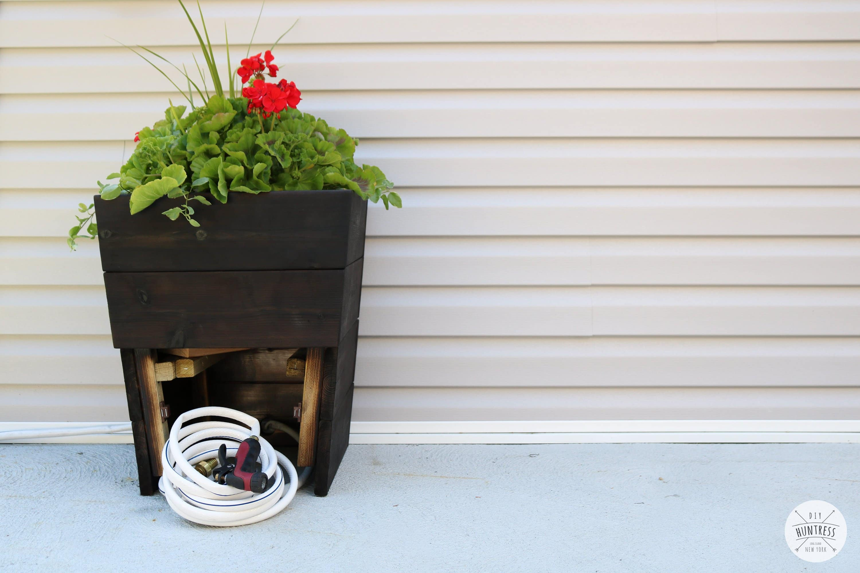 planter with hose storage