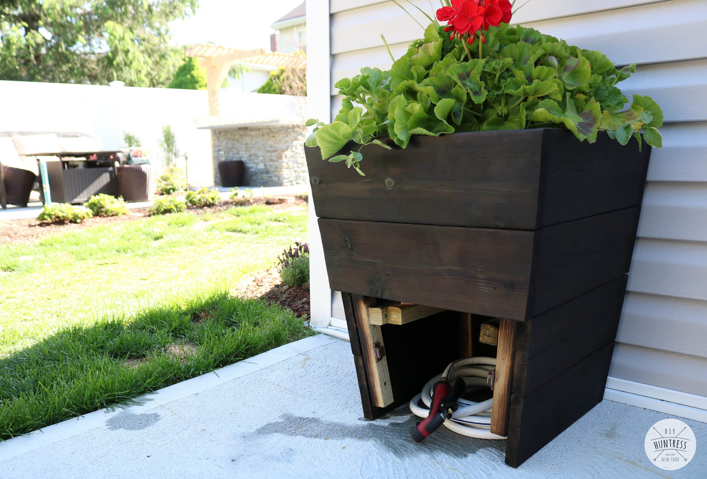 planter with hose storage