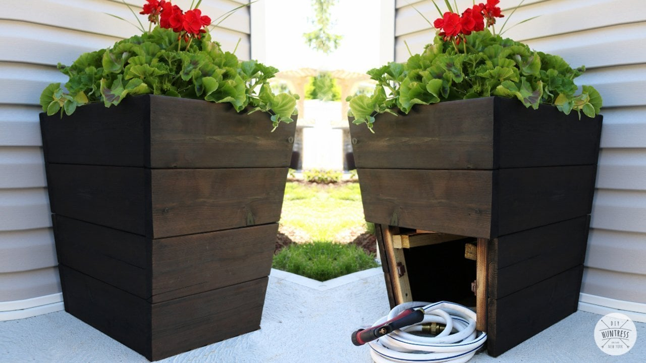 modern planter with hose storage