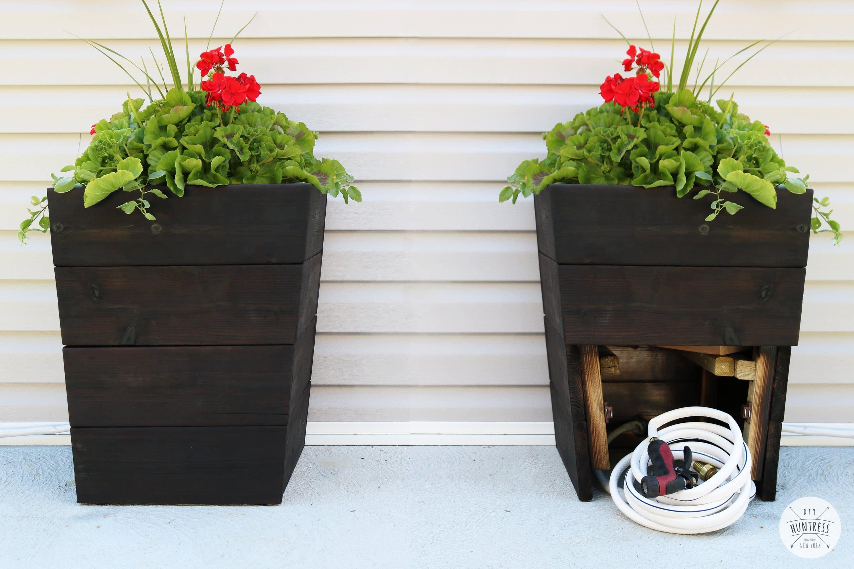 cedar planter with hose storage