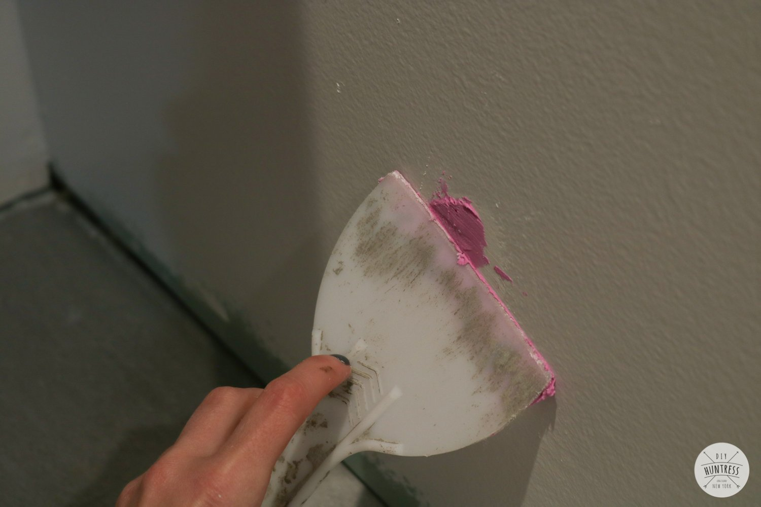 how to fix holes in walls