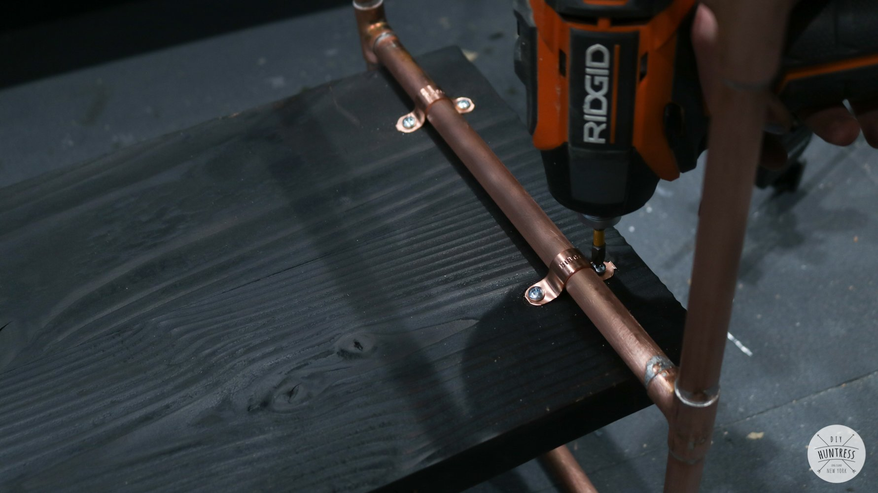 attaching copper pipe to wood