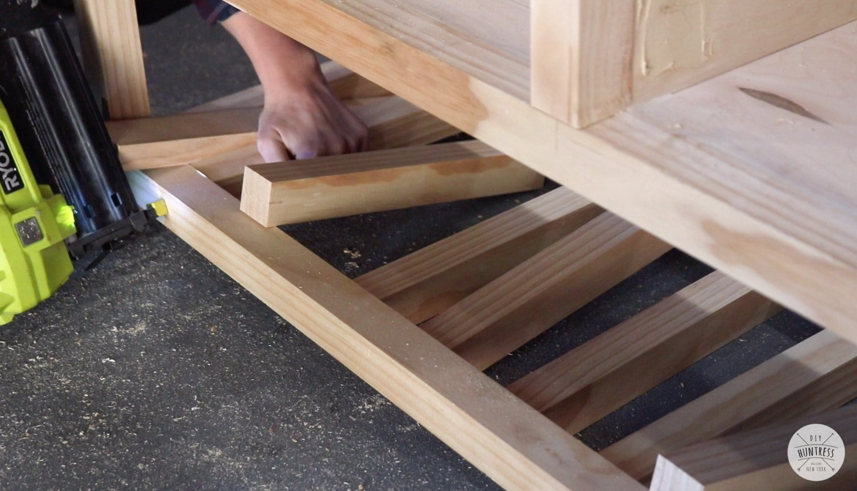 adding shelf pieces with brad nailer