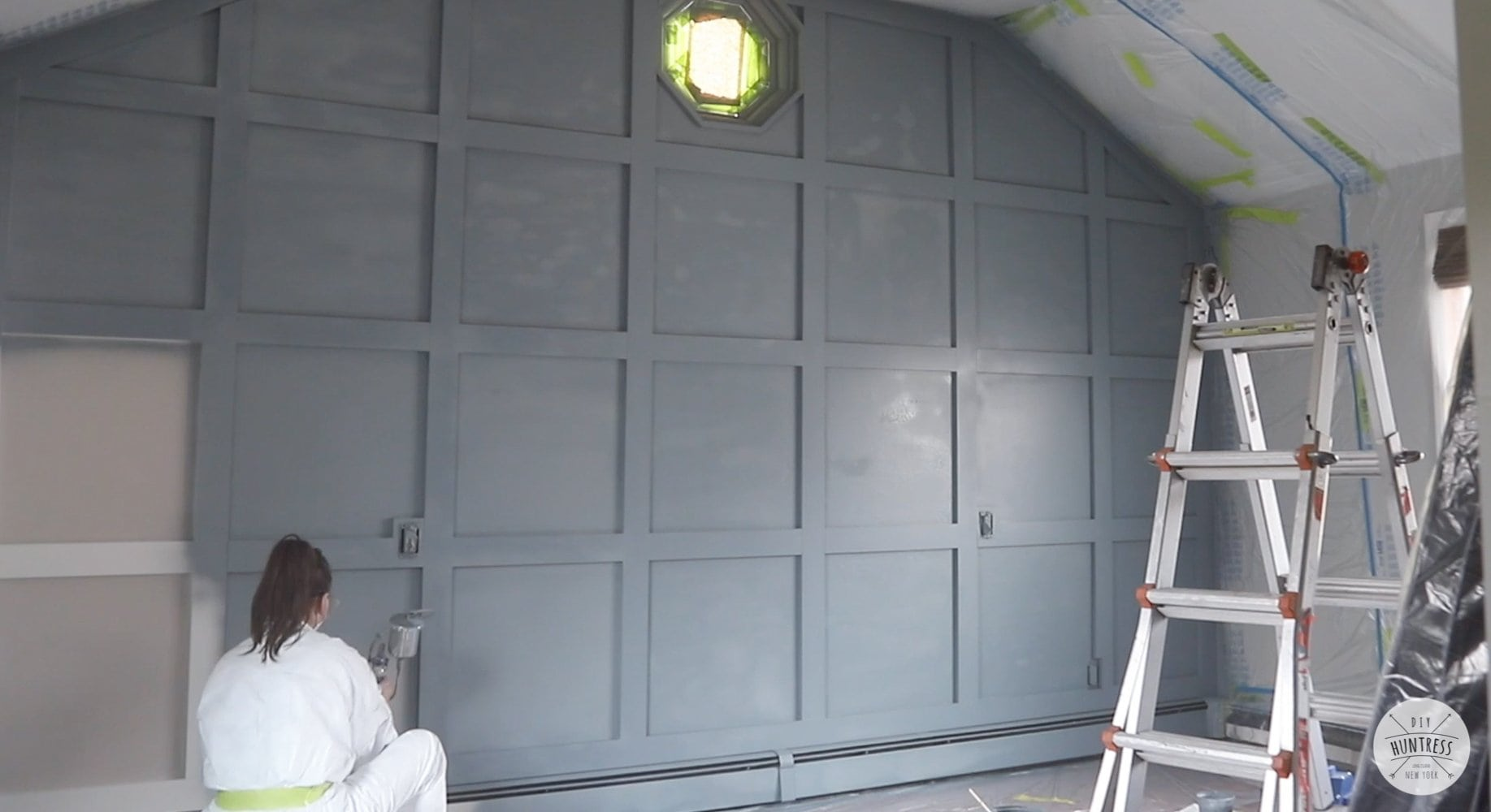using a spray gun on interior wall